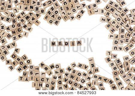 Media Written In Small Wooden Cubes