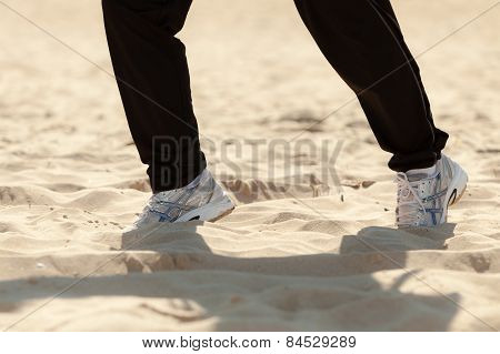 Jogging Walking. Female Legs Hiking On The Beach.