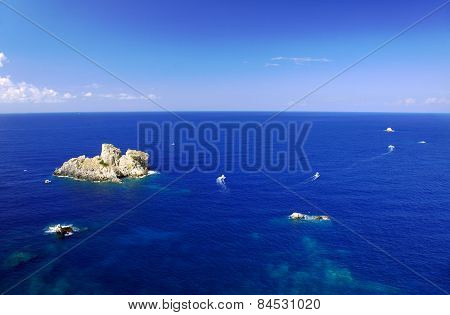 boats and rock beside Corfu island