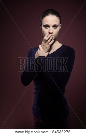 Scared Woman On Dark Background