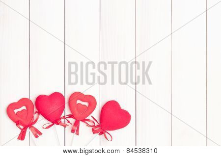 Four red hearts on sticks.