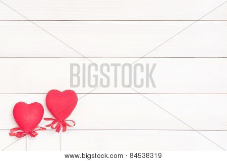 Two red hearts on sticks.