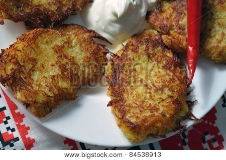 Closeup Of Thin Potato Pancakes With Hot Papper And Sour Cream
