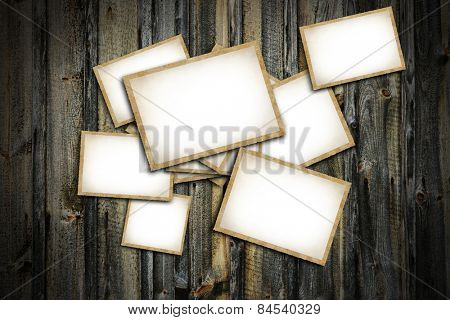 Vintage blank photo frames on wooden background