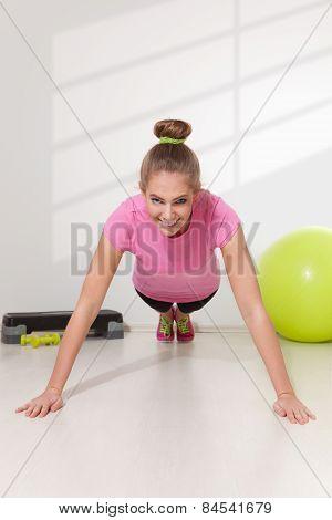 Happy Woman Doing Plank