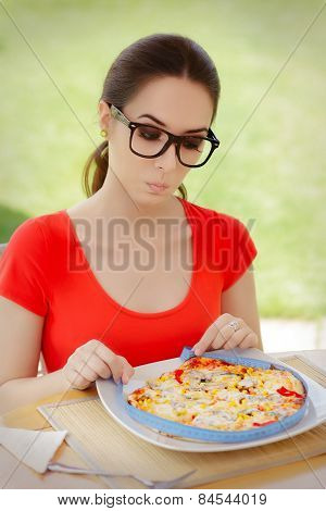 Surprised Woman Measures Pizza with Measure Tape