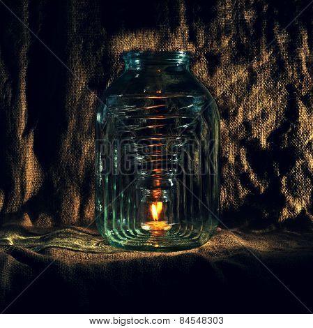 bottle. burning candle