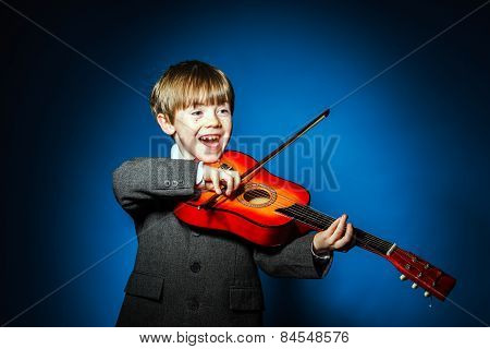 Red-haired Preschooler Boy With Ukalele, Music Concept
