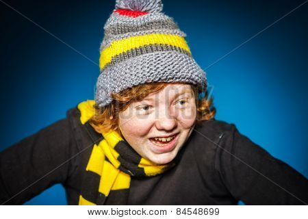 Expressive Teenage Boy Dressed In Colorful Hat Close-up Portrait