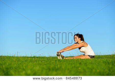 Sporty Woman Stretching Legs Outdoor
