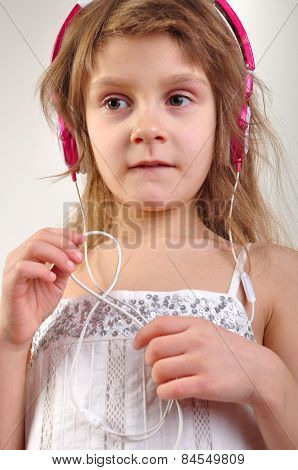 Child With Headphones Listening To Music