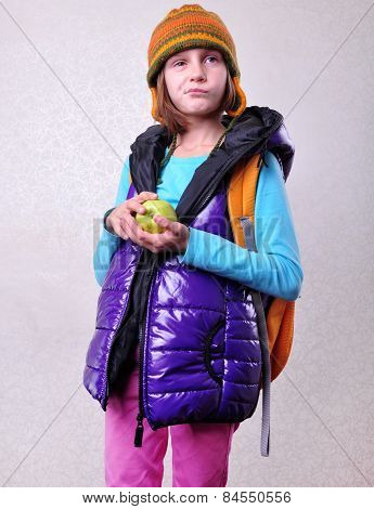 Scaptical Schoolgirl With Backpack And Apple