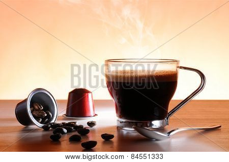Capsules And Cup Of Hot Espresso Coffee