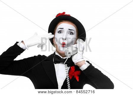 Woman In The Image Mime Holding A Handset