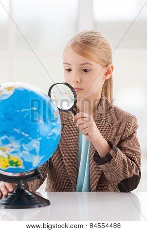 Examining Globe.