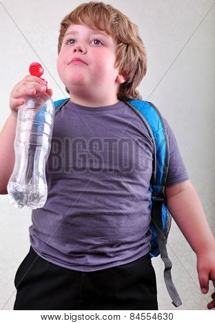 Cute Blond Boy With A Bottle Of Water