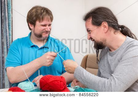 Two Men Are Fighting With Knitting Needles
