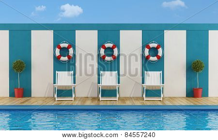 Pool With White Deckchairs