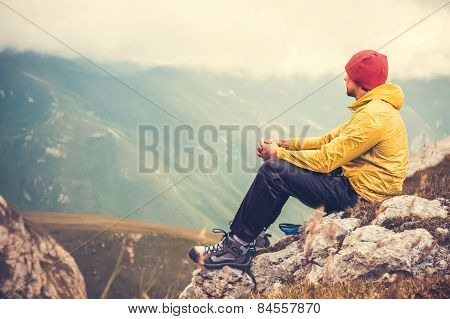 Man Traveler relaxing alone in Mountains Travel Lifestyle