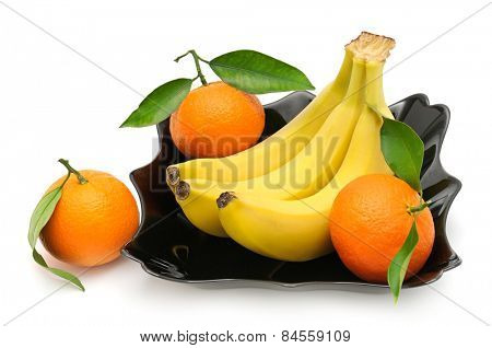 Tangerines and banana in plate isolated on white background