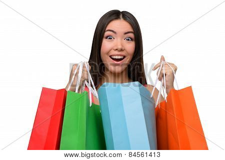 Asian surprised woman after shopping with bags