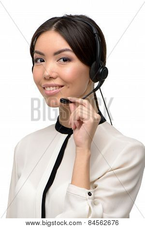 Asian call center female operator using headphones