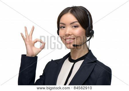 Asian call center female operator showing ok sign