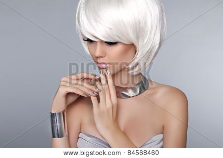 Blonde Bob Hairstyle. Fashion Beautiful Young Girl In Luxurious Jewelry Isolated On Grey Background.