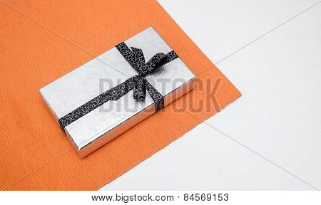 Silver Gift Box With Bow On White Background