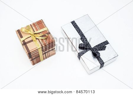 Brown And Silver Gift Box With Bow On White Background