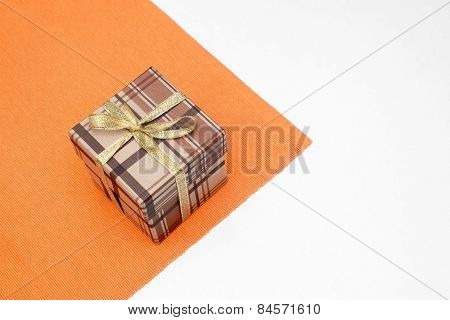 Brown Gift Box With Bow On White Background