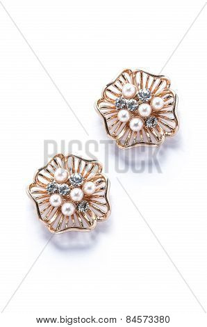 Gold Earrings With Pearls On White Background
