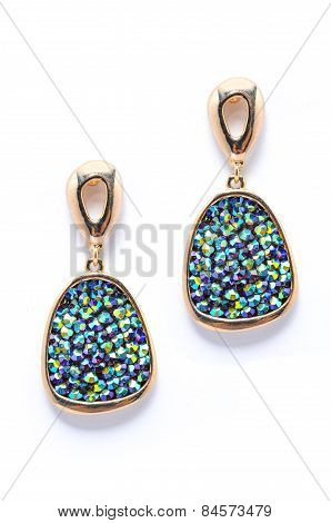 Earrings With Blue Gem Isolated On White Background