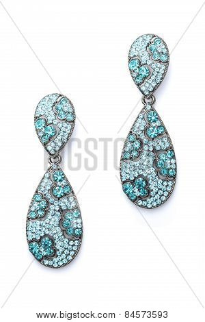 Blue Earrings In The Form Of Drops On A White Background