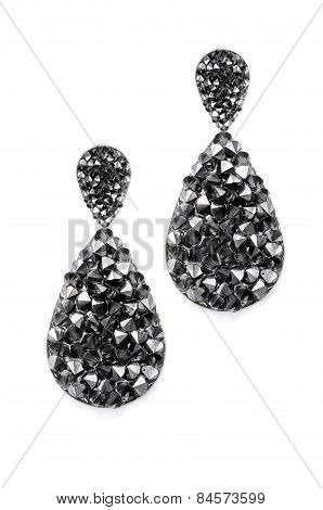 Black Earrings Droplets On A White Background