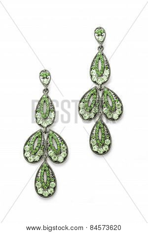 Earrings In The Shape Of The Leaves On A White Background