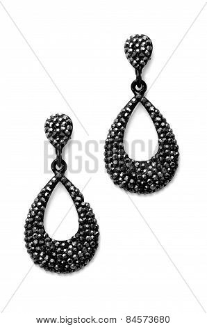 Earrings With Black Stones On A White Background