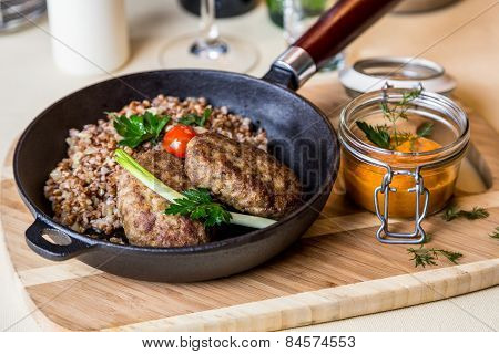 Restourant Serving Dish - Cutlet With Buckwheat On Wooden Board