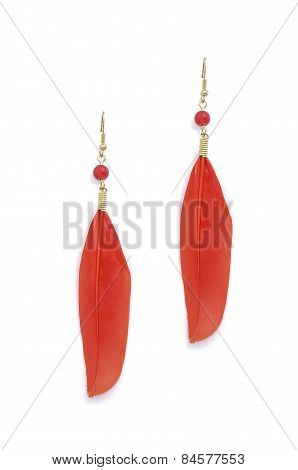 Earrings With Red Feathers On A White Background