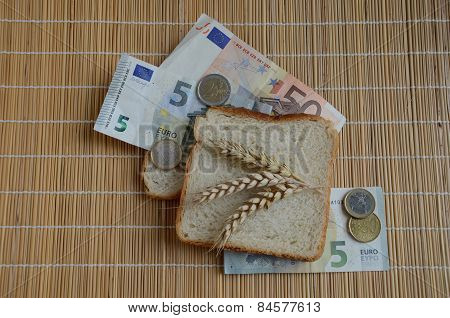 Slice Of Bread And Wheat Ears On Euro Banknotes