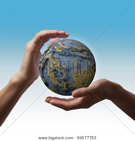 globe in the hands against the blue sky day environment