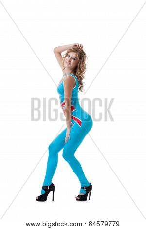Playful female dancer dressed in tight jumpsuit