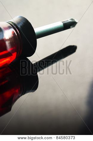 Red screwdriver with reflection