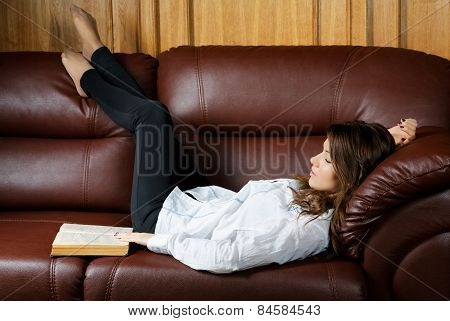 Sleeping Girl With A Book On The Couch
