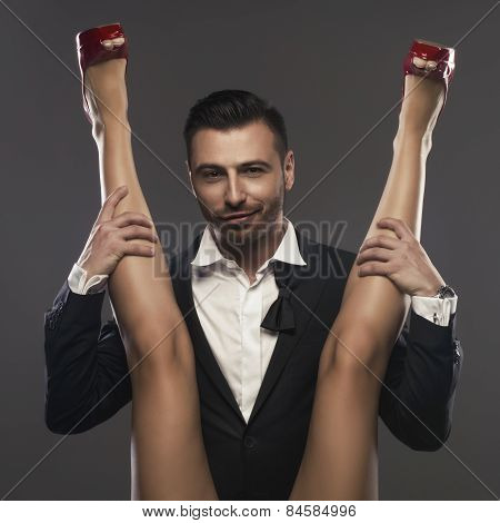 Elegenat Man Sitting And Is Spreading A Woman's Legs