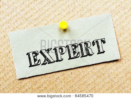 Recycled Paper Note Pinned On Cork Board. Expert Message. Concept Image
