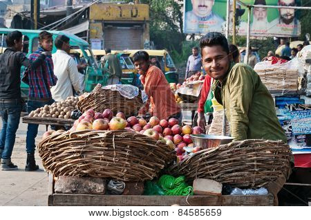 Indian Vendor With Fruit In Market