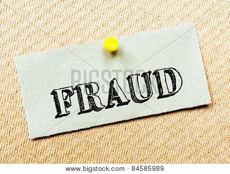Recycled Paper Note Pinned On Cork Board. Fraud Message. Concept Image