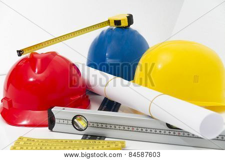 Colorful Helmets And Tools For Construction Drawings And Buildings
