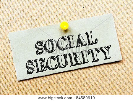 Recycled Paper Note Pinned On Cork Board. Social Security Message. Concept Image